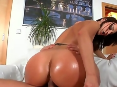 Dark haired doxy Simone Style with huge jaw dropping ass and cheep make up in lingerie and high heels rides on young guy Meeo to loud agonorgasmos in living room action.