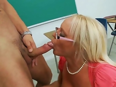 Gorgeous spectacled golden-haired teacher Alexis Golden is having valuable sex with her student Danny Mountain in this movie. She is kneeling and starting to perform sexy fellatio.