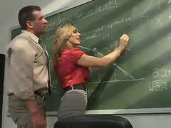 Amazing blond milf pornstar Tanya Tate with a big and very tasty boobs seduces her student in the classroom. This hot bitch receives licked on a table and with a joy sucks a cock.