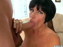 Turned on knob hungry black haired aged cougar Shay Fox with biggest firm balloons and large soaked butt rubs her shaved minge and gives lusty blowjob to youthful dude with biggest cock.