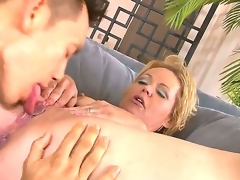 Fleshly golden haired milf Kelly Leigh with big tits and bald minge acquires her legs spread and bald taco licked on the sofa by concupiscent juvenile lover and enjoys in getting pounded