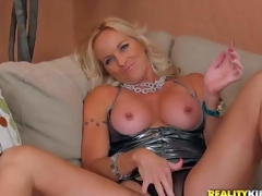 Dani is a perfect bodied golden-haired milf in greatly sexy short dress. This babe pulls out her awesome round tits and widens her legs wide to play with her mature pussy in front of the camera