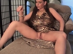 Breasty milf in slutty dress pumps her pussy