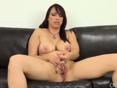 This babe squeezes her tits and reaches down to diddle her soaked slit
