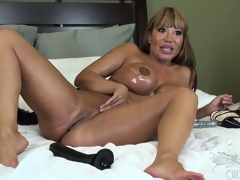 The dark brown female-dominator enjoys every moment of the intensive masturbation session