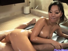 Oriental babe Asa Akira engulfing a guy's cock after a slutty nuru massage