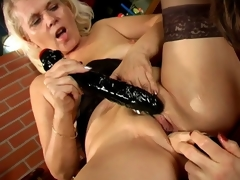 Trashy lesbian grannies Marketa And Leona licking their succulent pussies and sharing a biggest sex tool