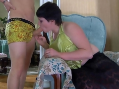 Crummy mommy hungrily sucks on a boy's rod desirous to feel it inside her box
