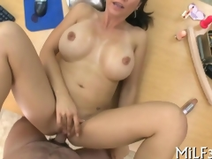 MILF with luscious tits fucked on an office table