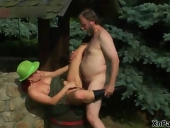 Gung-ho old man fucking this mature cunt in the woods