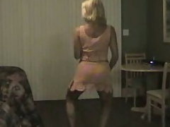 Mature golden-haired milf dancing and gets her large bumpers out and flashes her pussy too.